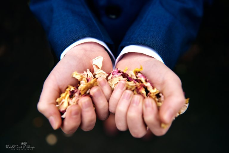 Hands holding wedding confetti