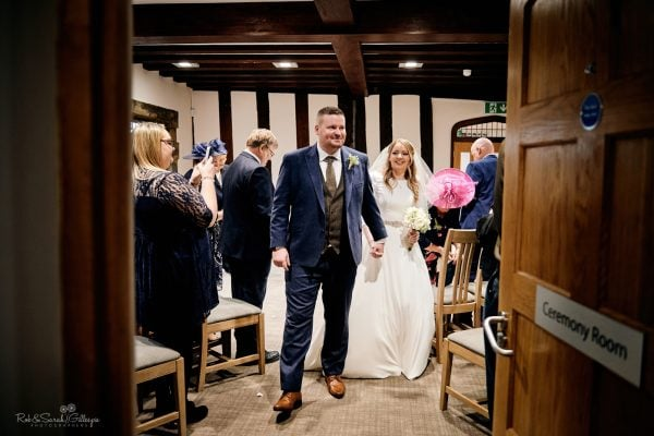 Newly married couple leave wedding ceremony at The Henley Room