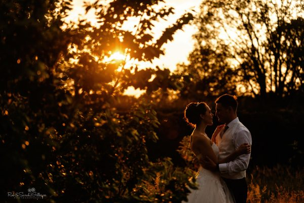 Bride and groom at home wedding with beautiful sunset