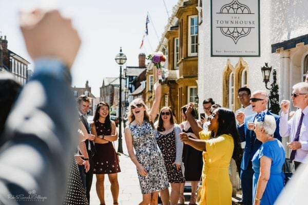 Wedding guests picks up bouquet in Stratford upon Avon town centre