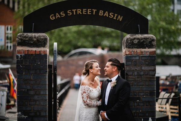 Bride and groom in canal area of central Birmingham