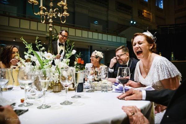 Bride laughing at wedding speeches in Birmingham Town Hall