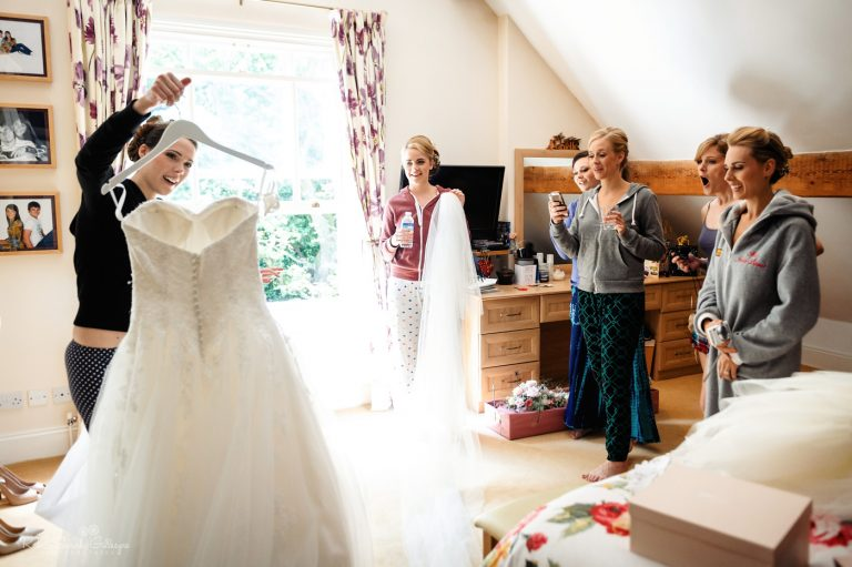 Bridesmaids react to seeing bride's wedding dress