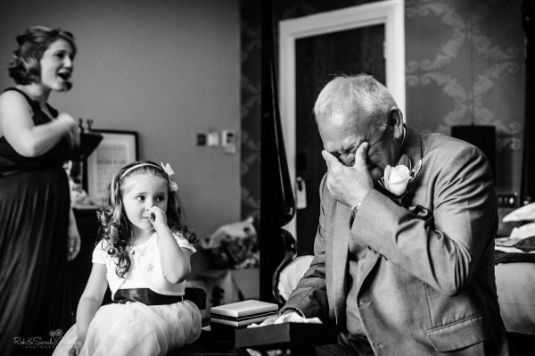 Grandfather crying after receiving gift from bride
