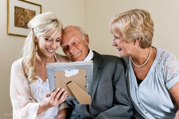 Bride, mum and grandfather react emotionally to gift