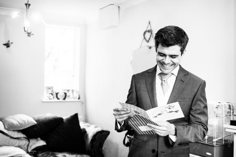 Groom reacts to reading card from bride