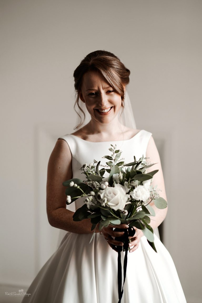 Portrait of beautiful redhead bride laughing