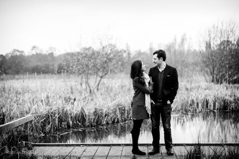 Engagement photo shoot couple standard on boardwalk in marshes