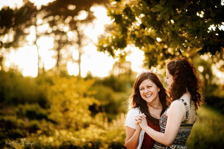 Engagement photo shoot with two brides relaxed and happy