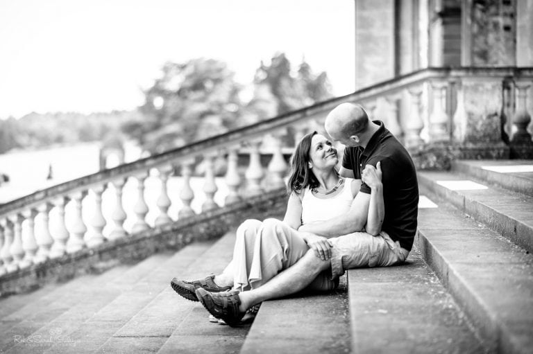 Couple relaxed and happy sitting on stone steps