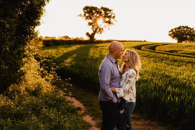 Couple photo shoot in beautiful field at sunset