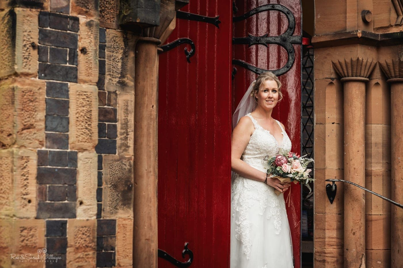 Portrait of bride in doorway of St John's church Walmley