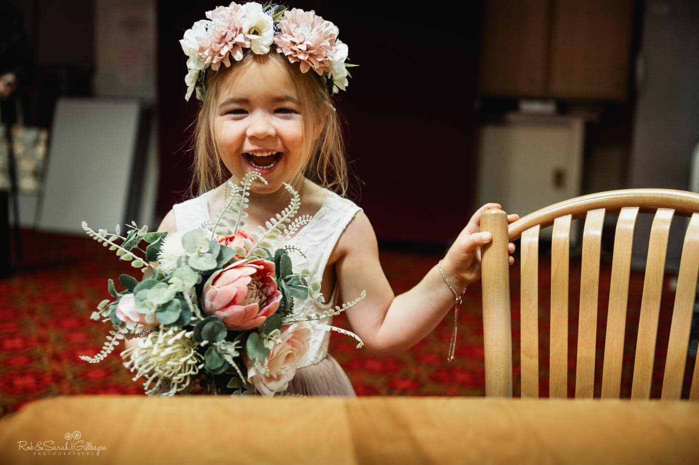 Flowergirl laughing at small wedding in church