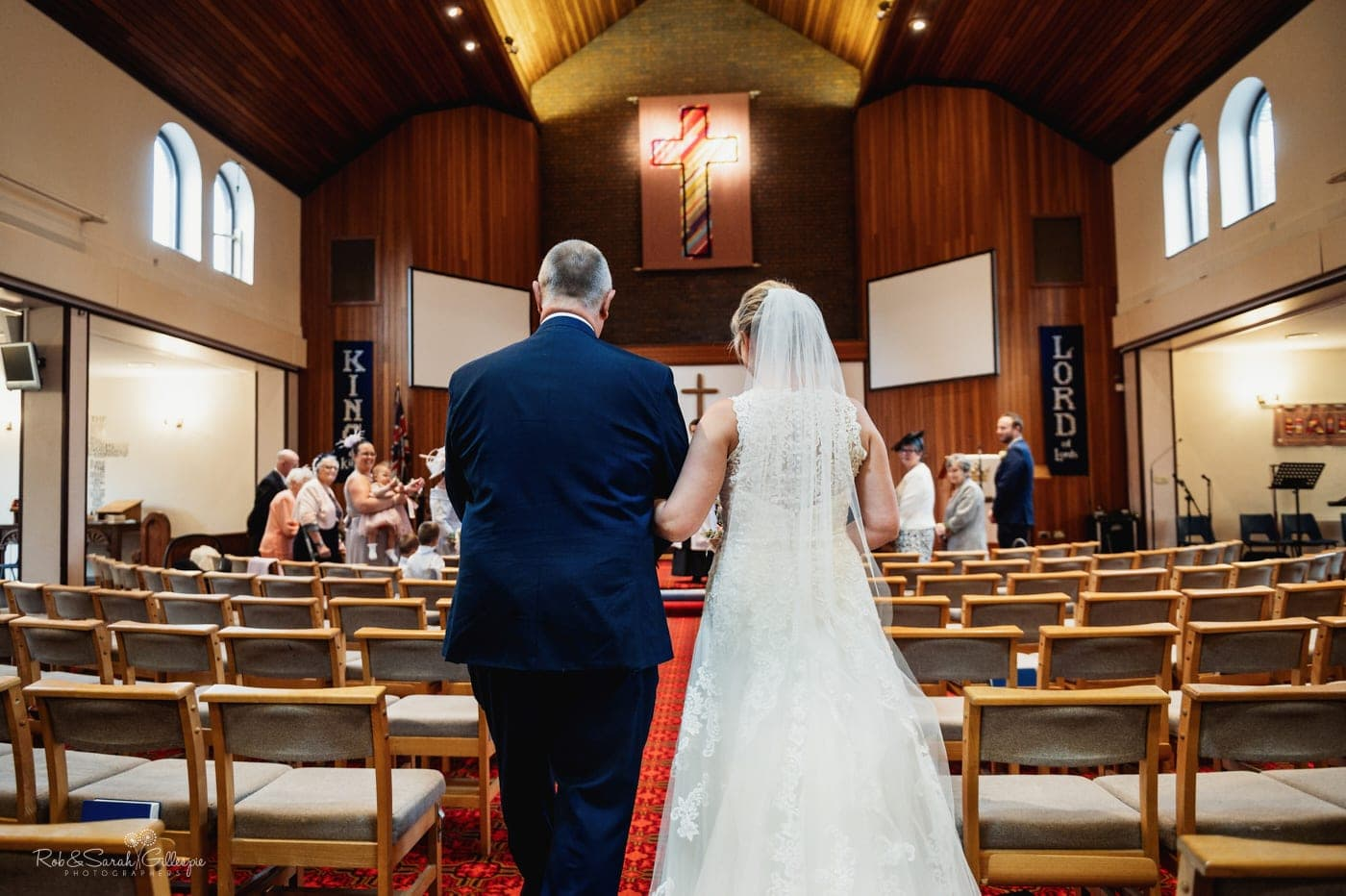 Bride and dad enter small wedding service in church