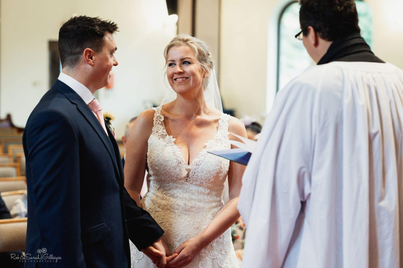 Bride smiling at groom during small wedding service