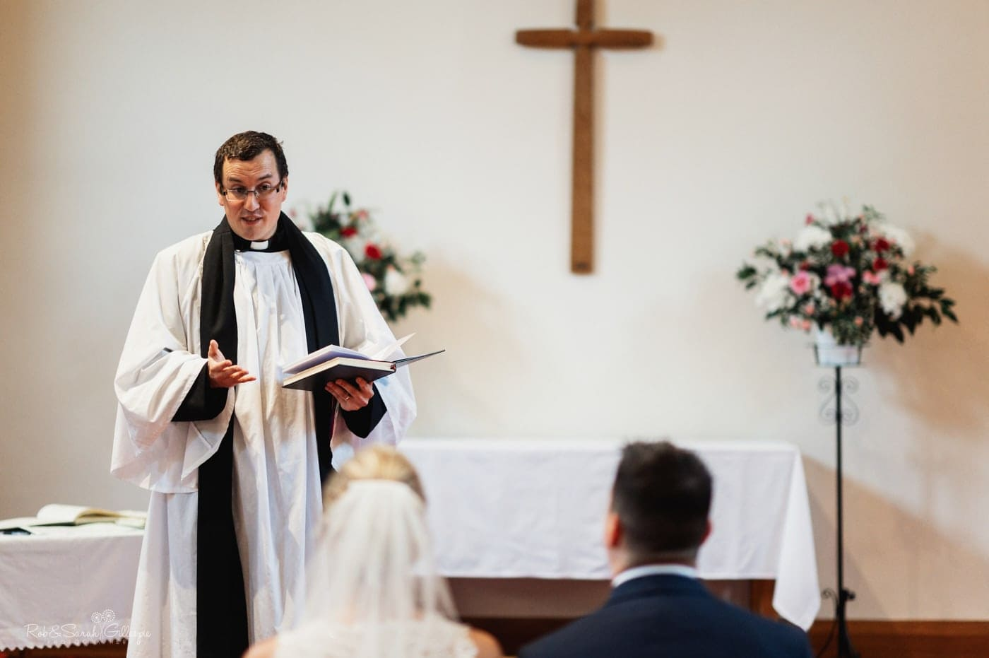 Vicars gives surmon during small wedding at St John's church Walmley