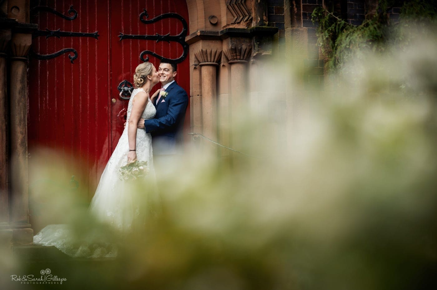 Bride and groom couple photos outside church