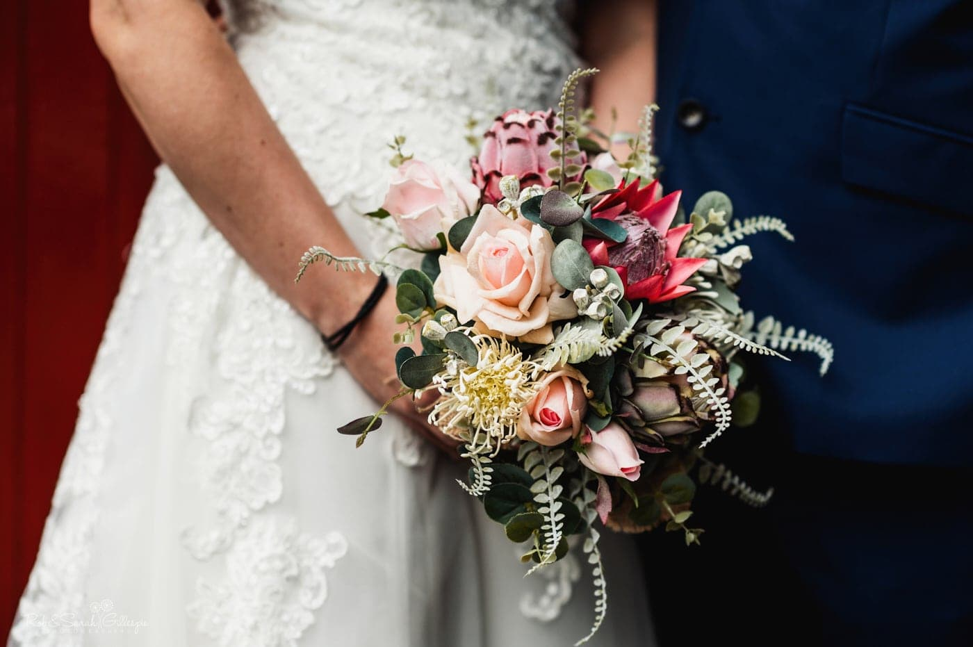 Close up of bridal bouquet at small wedding