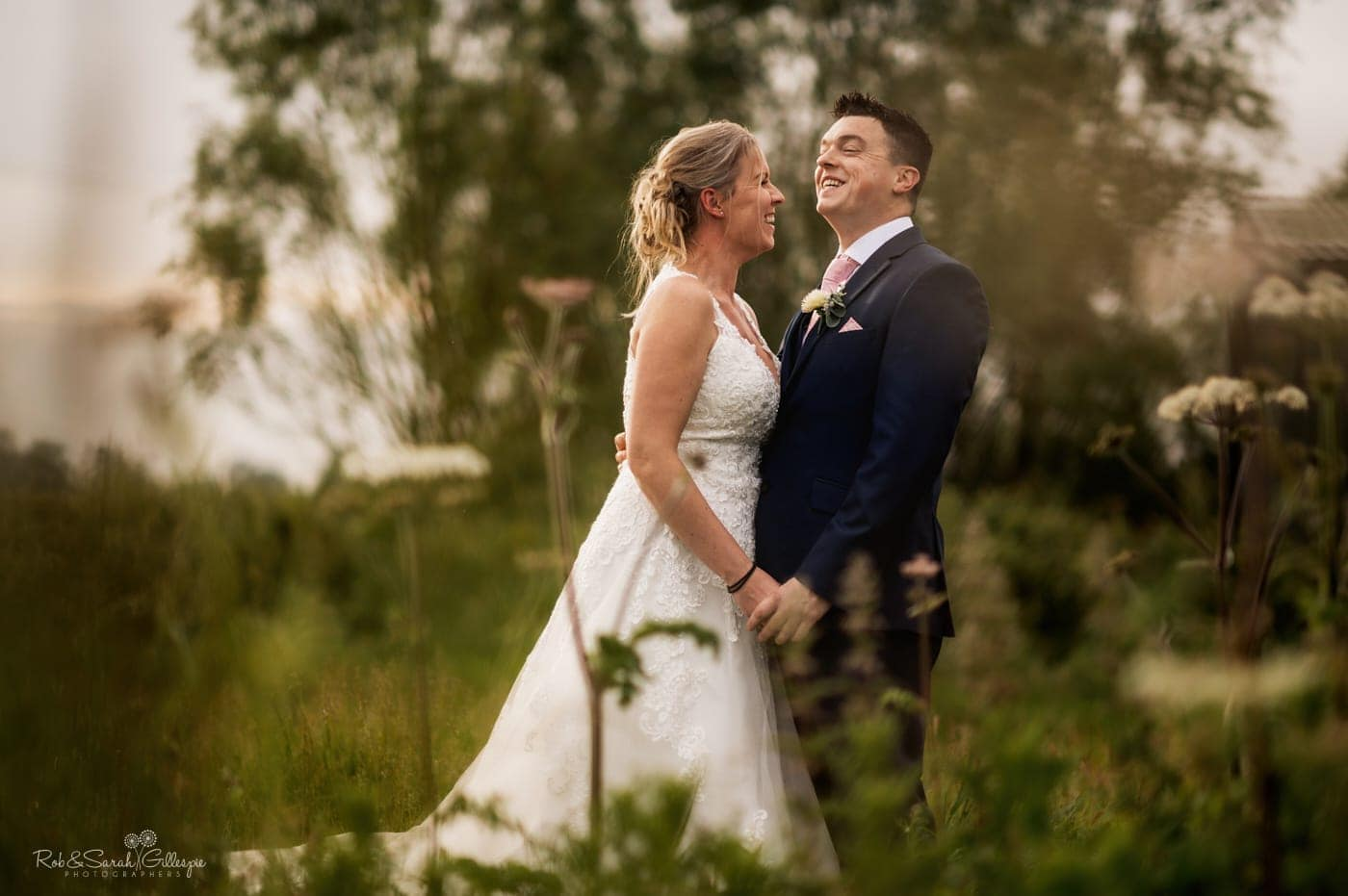 Bride and groom in fields at Wishaw Country Sports small wedding