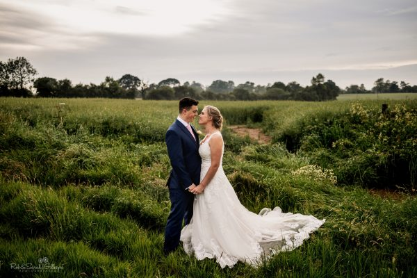 Bride and groom in field at Wishaw Country Sports