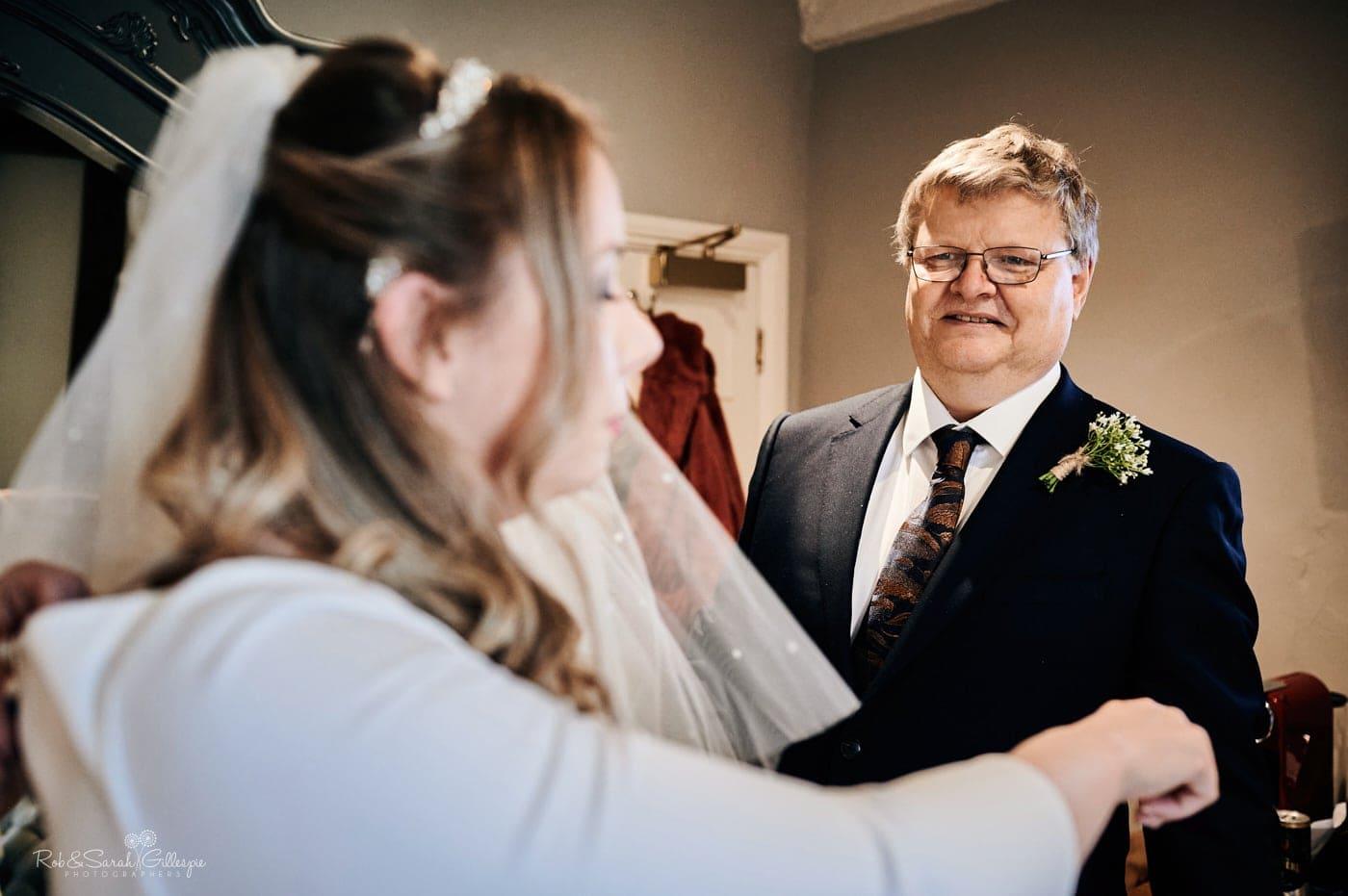 Bride's dad sees her in wedding dress