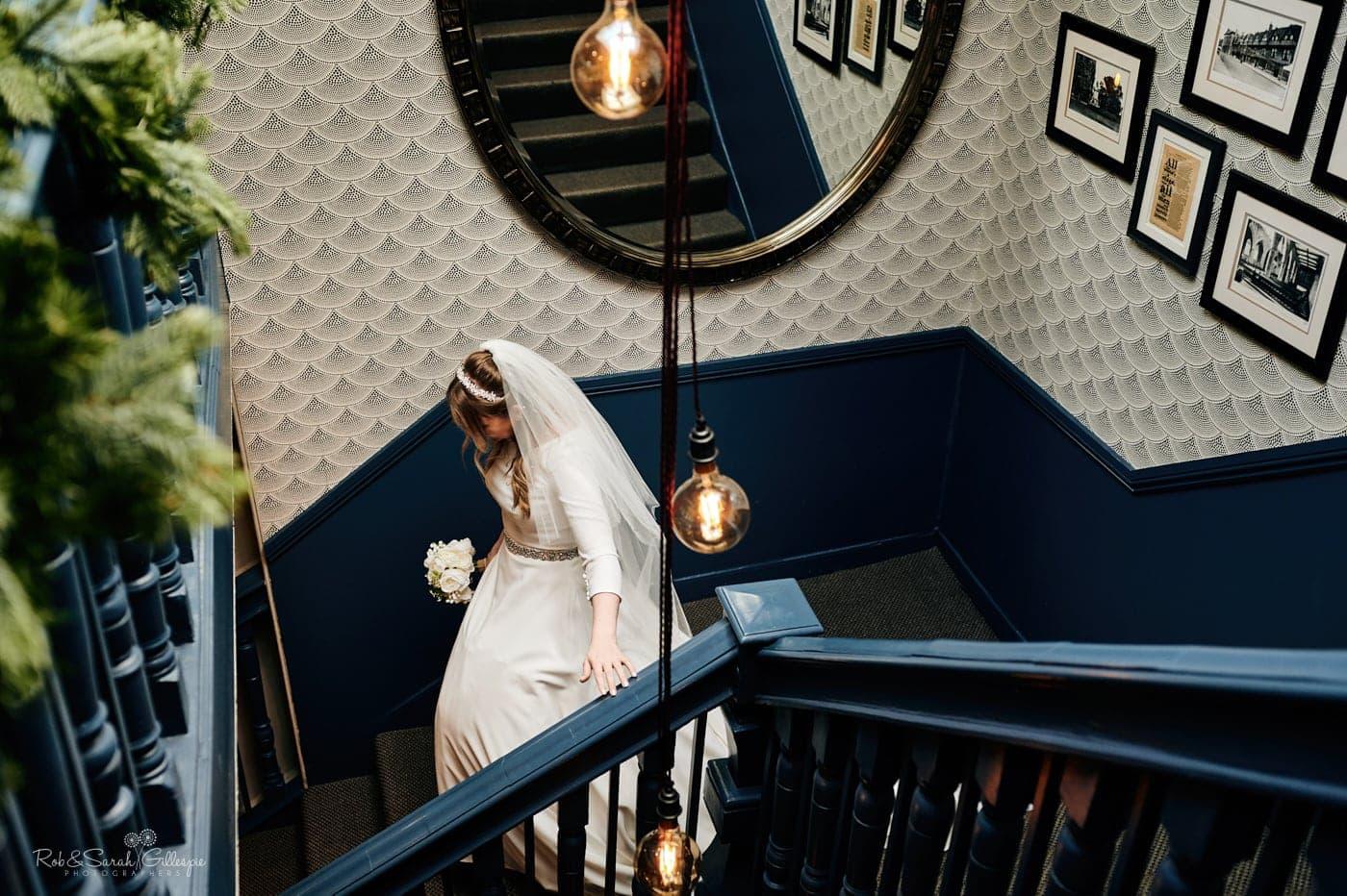 Bride walks down staircase