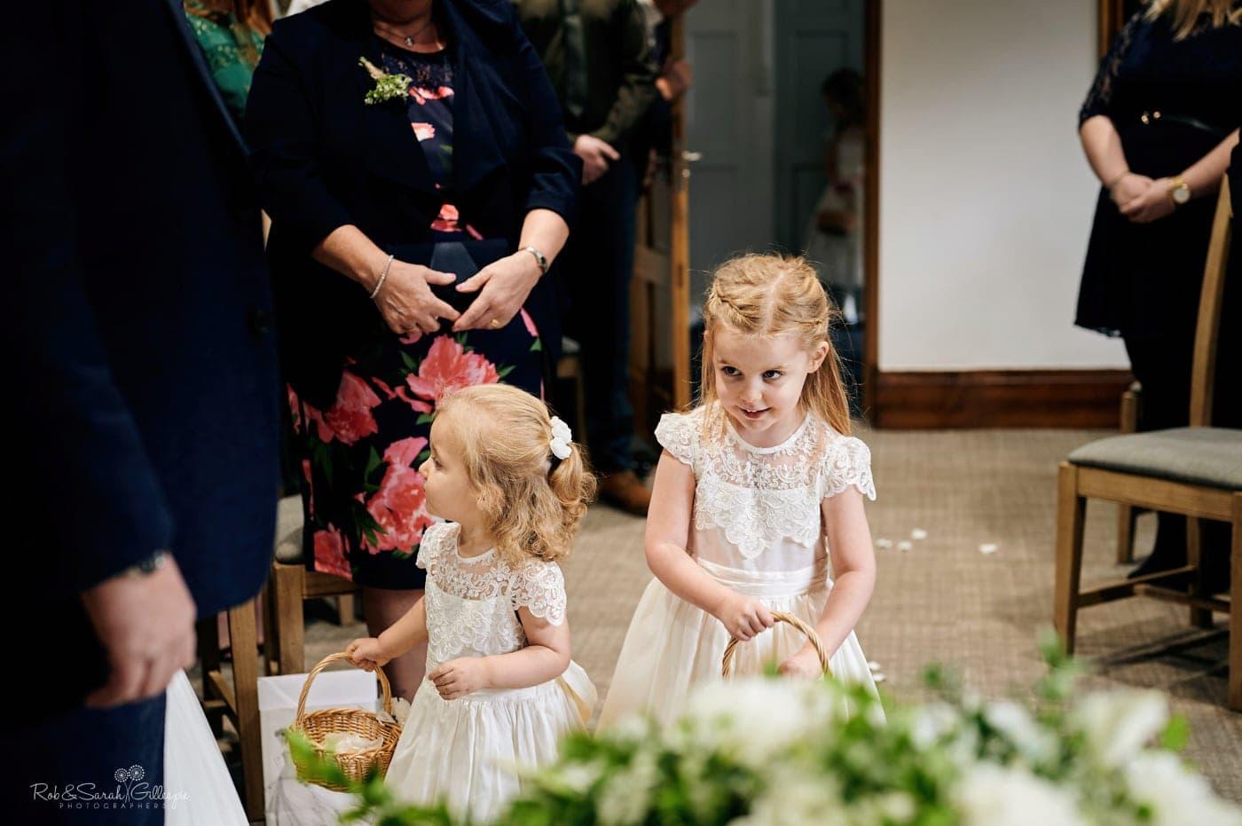 Flowergirls enter wedding ceremony at The Henley Room in Stratford-upon-Avon