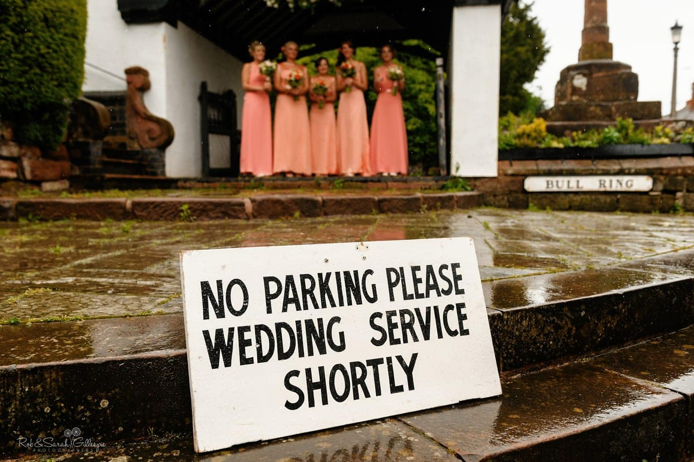 No parking sign outside church with bridesmaids in background