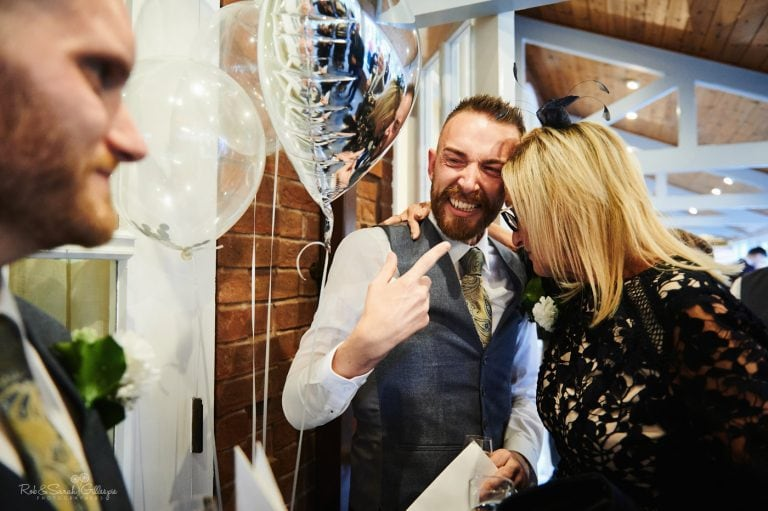 Two grooms emotional after wedding ceremony
