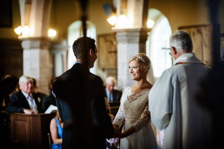 Bride and groom exchange wedding vows in church