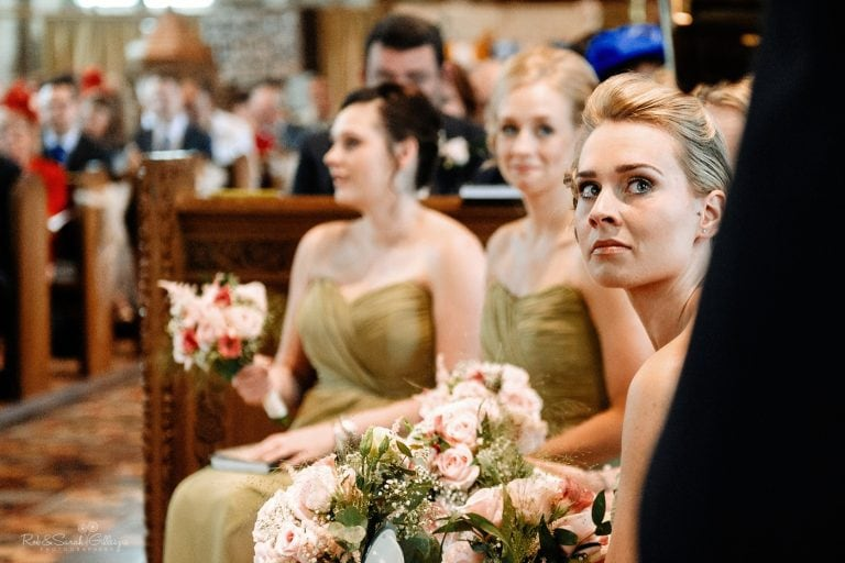 Bridesmaid with tears in her eyes during wedding ceremony