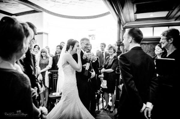 Bride regains composure as she walks up aisle