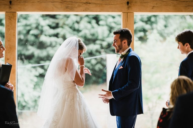 Bride pauses to catch breath during wedding ceremony