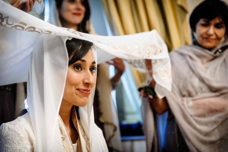 Bride pauses for reflection during Islamic marriage service