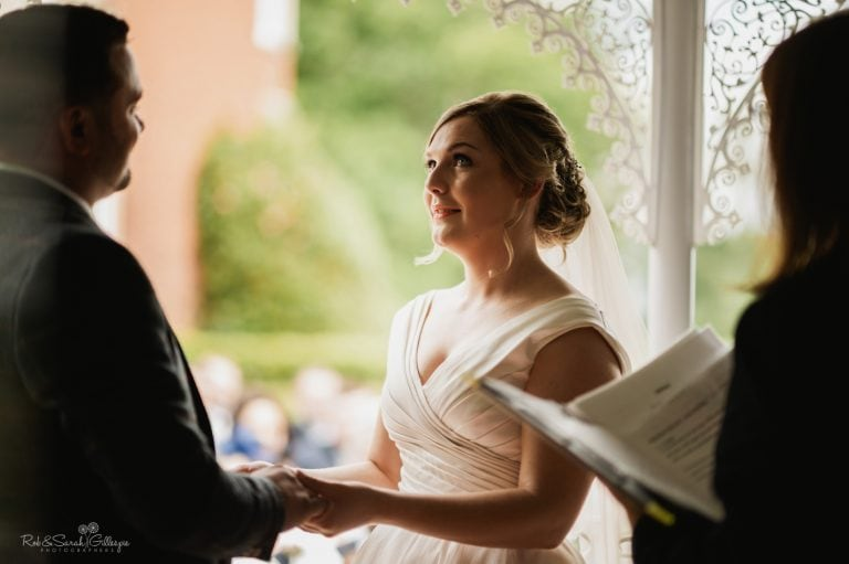 Bride pauses with tear in eye during wedding vows
