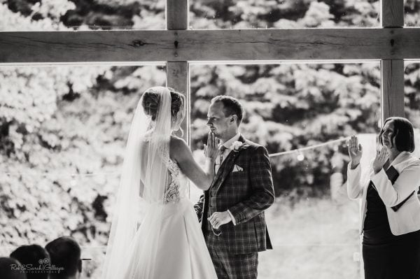 Bride wipes groom's lip during wedding