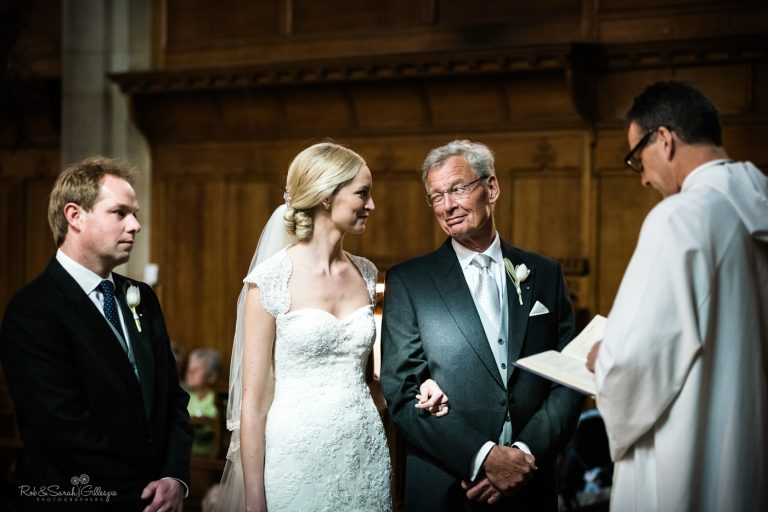 Dad winks at daughter during wedding ceremony