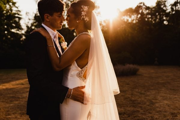 Bride and groom about to kiss in beautiful evening light