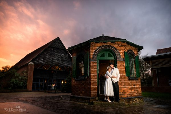 Bride and groom at wedding venue with old buildings