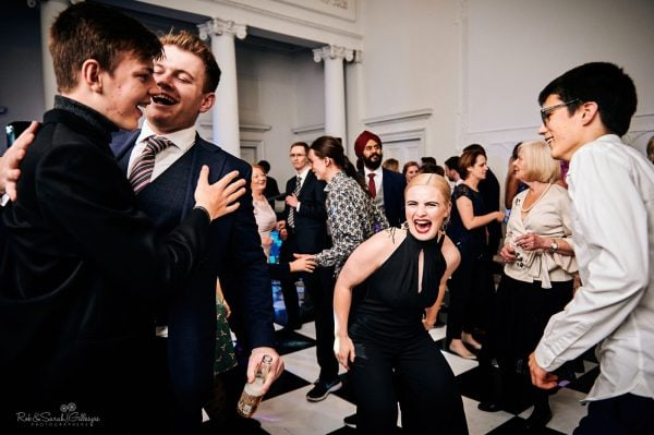 Guests dance at wedding party