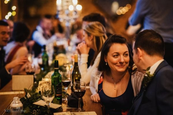 Couple share quiet moment during evening wedding party