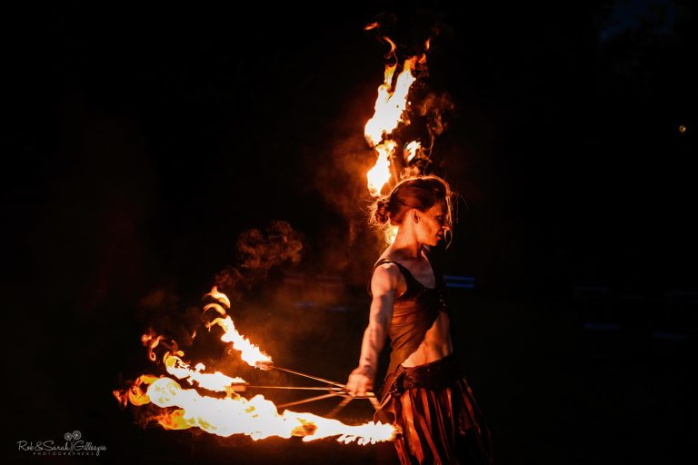Fire performers at evening wedding party