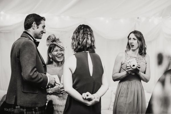 Wedding guest pulls funny face as she overhears guests chatting