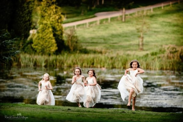 Young girls runing across lawn during evening wedding party