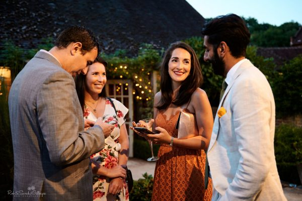 Wedding guests chat and relax outside