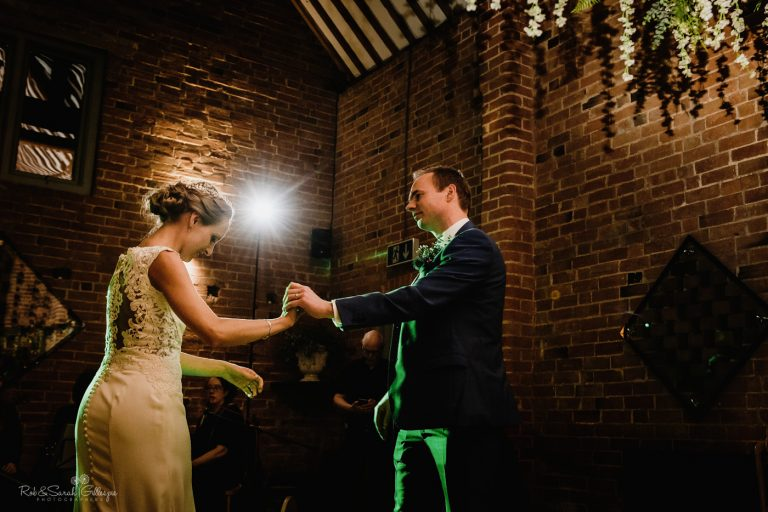 Bride and groom first dance at barn venue wedding