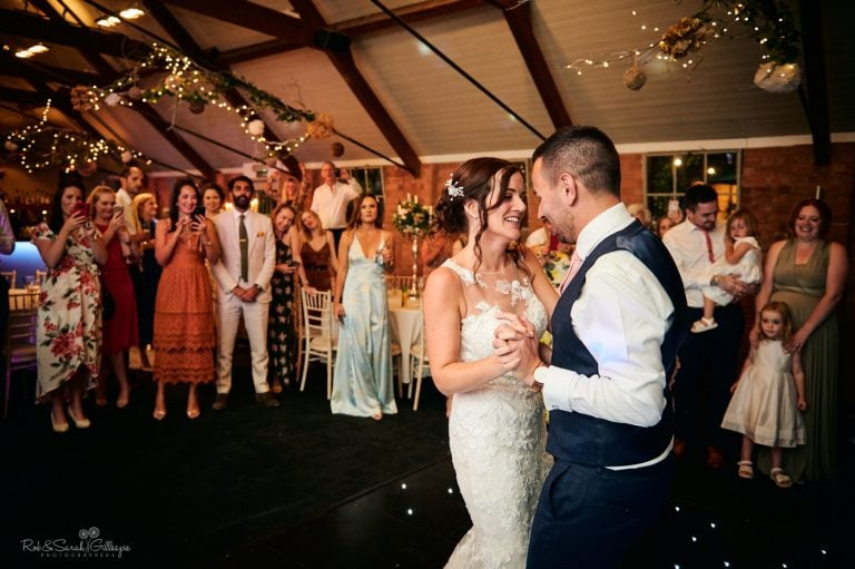 Bride and groom relaxed and smiling during first dance