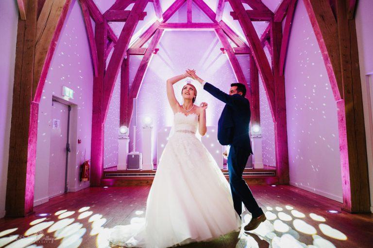 Groom spins bride during wedding first dance