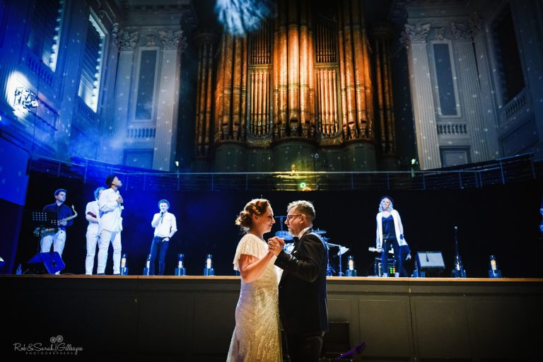 Bride and groom first dance in town hall wedding