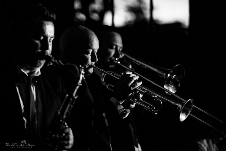 Saxophone and trumpet players perform at wedding party